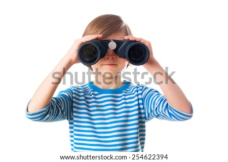 Little boy is looking through binocular, isolated on white background - stock photo