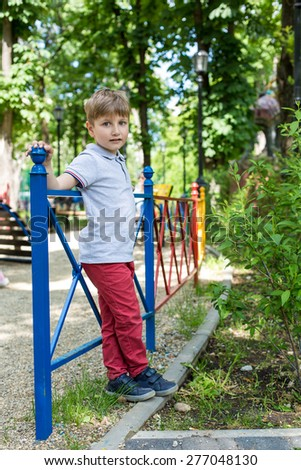 Little boy is playing Frisbee on a sunny day - stock photo
