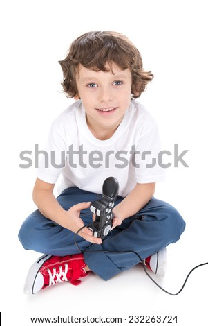 Little boy is playing videogames isolated in white. - stock photo