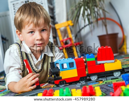Little boy is playing with a  train