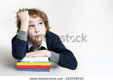 Little boy is tired to read his book, on white background