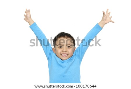 little boy  isolated on white and is wearing a blue shirt and he has a happy, excited expression on his face - stock photo