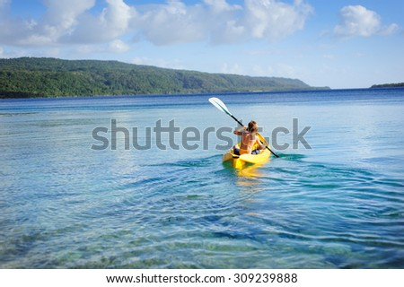 Little boy kayaking at the lake