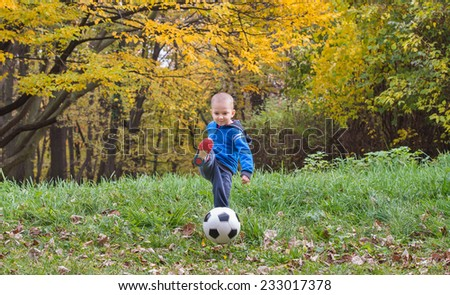 little boy kicking ball
