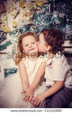 Little boy kissing girl christmas stock photo edit now shutterstock little boy kissing a girl in christmas thecheapjerseys Gallery