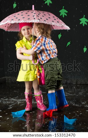 Little boy kissing girl on cheek stock photo edit now 153312470 little boy kissing a girl on the cheek under a pink umbrella altavistaventures Images