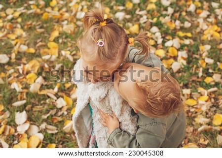 Little boy kissing a little girl. Selective focus on eyes - stock photo