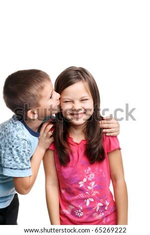 little boy kissing beautiful little girl - stock photo