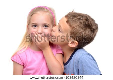 little boy kissing girl white background - stock photo