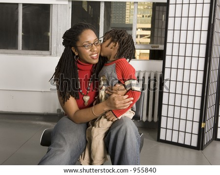 Little boy kissing his mother - stock photo