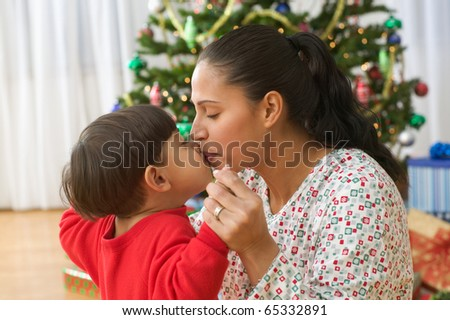 Little boy kissing mom - stock photo