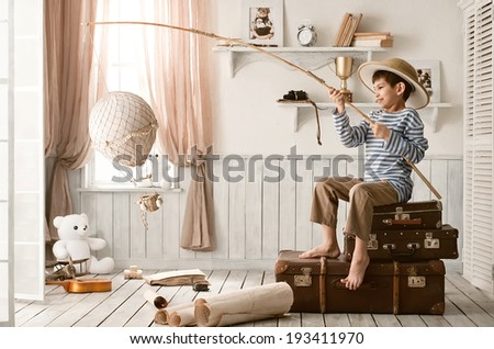 Little boy launches a balloon through the open window - stock photo