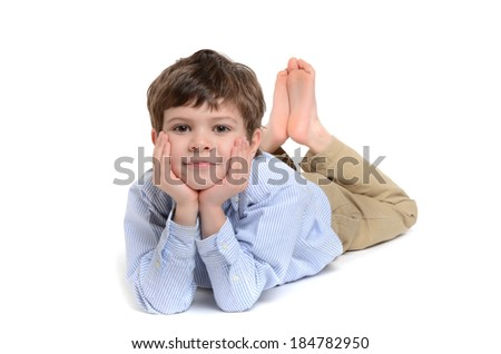 little boy laying on stomach white background - stock photo