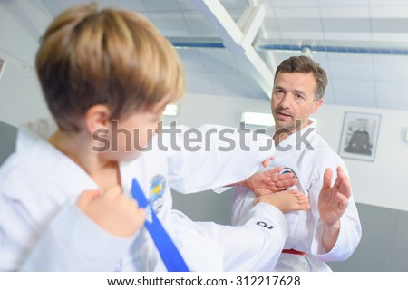 Little boy learning a martial art - stock photo
