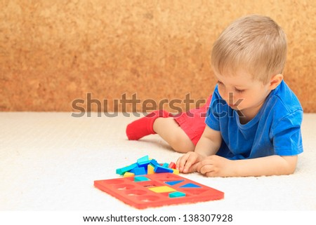 little boy learning shapes - stock photo
