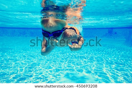 little boy learns swimming underwater - stock photo
