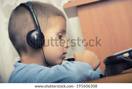 little boy listening to music - stock photo