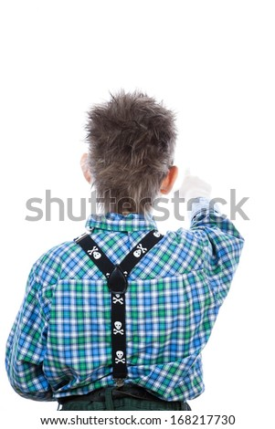 Little boy looking and pointing the camera on the white background