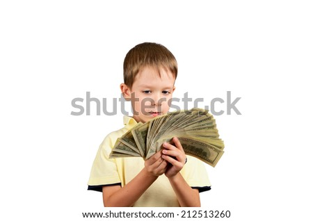 little boy looking at a stack of 100 US dollars bills and think what to do. isolated on white background. horizontal - stock photo