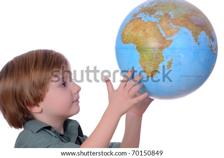 little boy looking at globe isolated on white