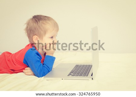 little boy looking at laptop, early leaning and modern technology