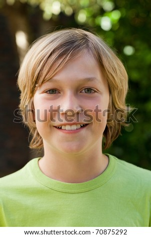 Little boy looking at the camera in the garden