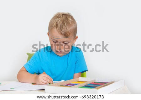 Little boy looking for a drawing concept