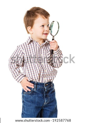 Little boy looking through magnifying glass, isolated on white - stock photo