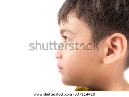 Little boy looking up with smiling on white background - stock photo
