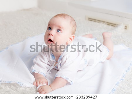 Little boy lying on belly and looking up
