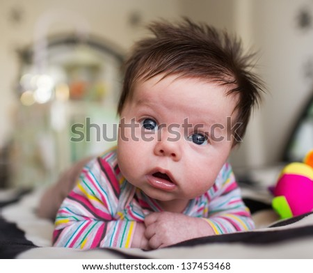Little boy lying on the bed at home - stock photo