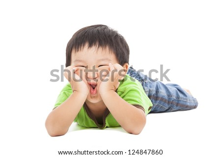 little boy makes a funny face - stock photo