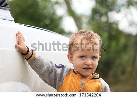 little boy near a car