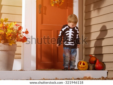 Little Boy Near Halloween Pumpkin In The Courtyard. Halloween Theme - stock photo