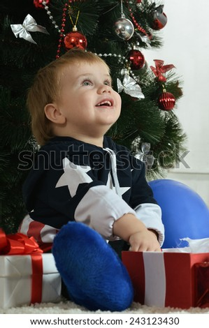 Little boy near new year tree - stock photo