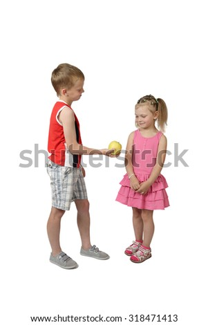 Little boy offers apple to girl isolated on white background