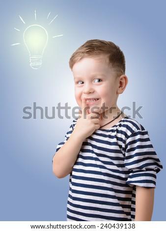 little boy on a background of light bulbs. idea - stock photo