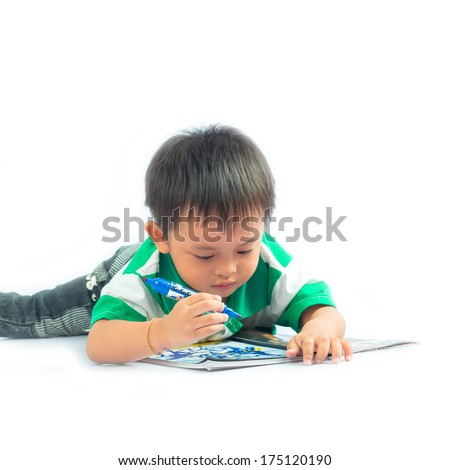 Little boy on a floor with a diary. Isolated over white background.