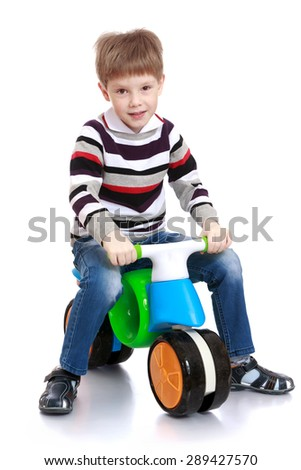 Little boy on a plastic bike-Isolated on white background