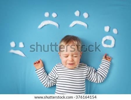 little boy on blue blanket background - stock photo