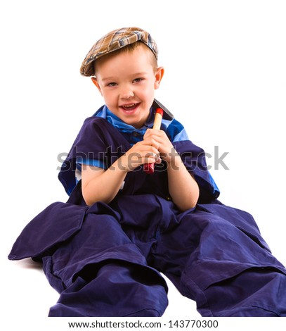 Little boy on jumpsuit and little hammer, white background - stock photo