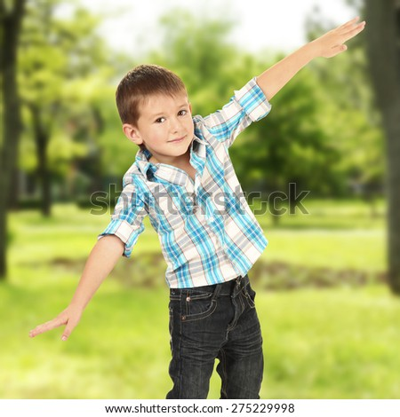 Little boy on nature background - stock photo
