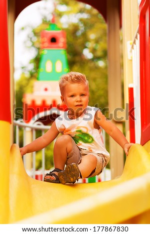 little boy on playground - stock photo