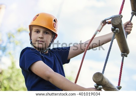 Little boy on ropes course