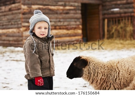 Little boy on the farm in winter