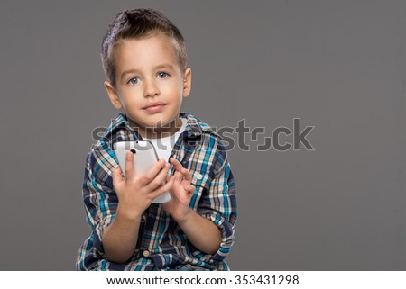 Little boy on the phone sets - stock photo