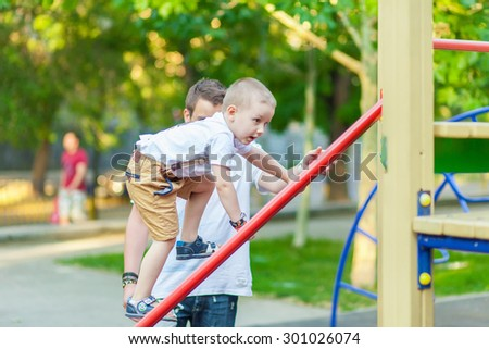 little boy on the playground in park - stock photo