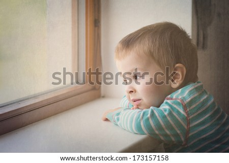 Little boy on the window