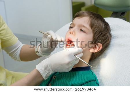 little boy opening his mouth wide during inspection of oral cavity  - stock photo