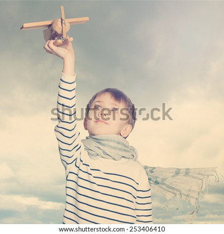 Little boy outdoors under the sky, holiday concept - stock photo